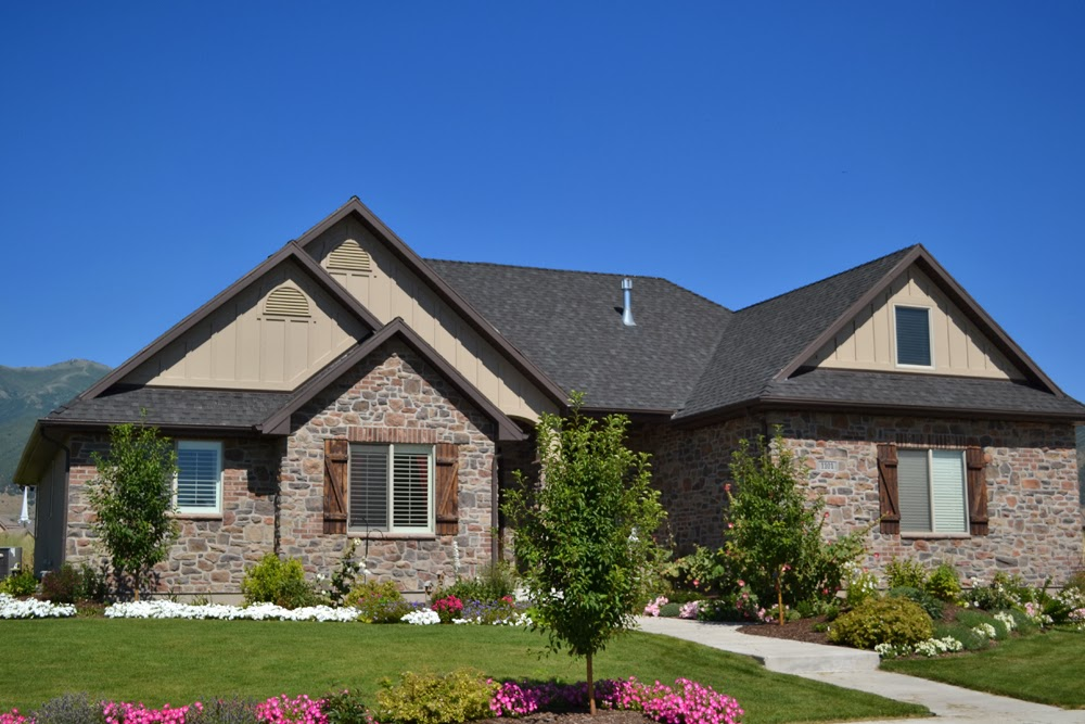 Shutters with brick stone hearth and home distributors for Brick houses with stone accents