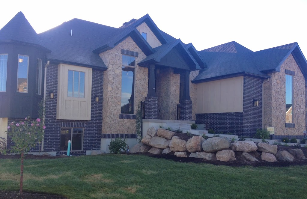 Black white houses hearth and home distributors of for Brick homes with stone accents