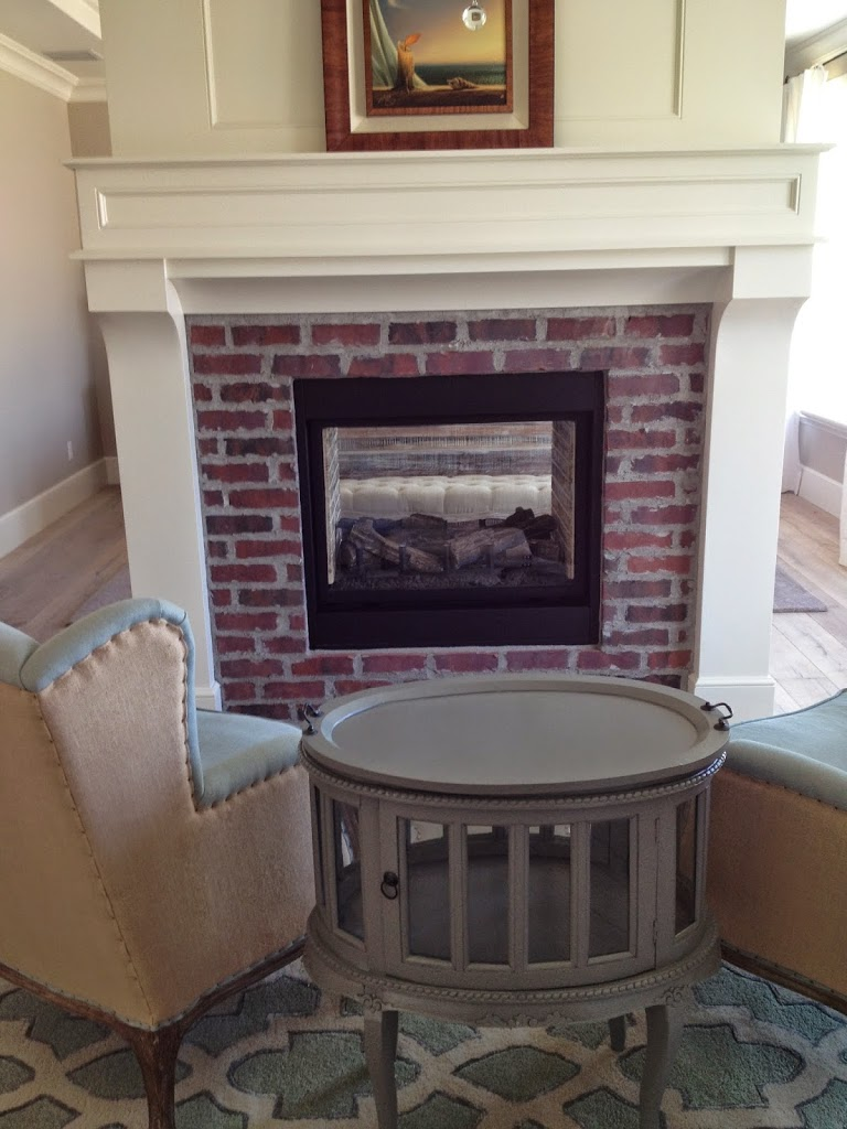 brick fireplaces with white surround mantels hearth and home