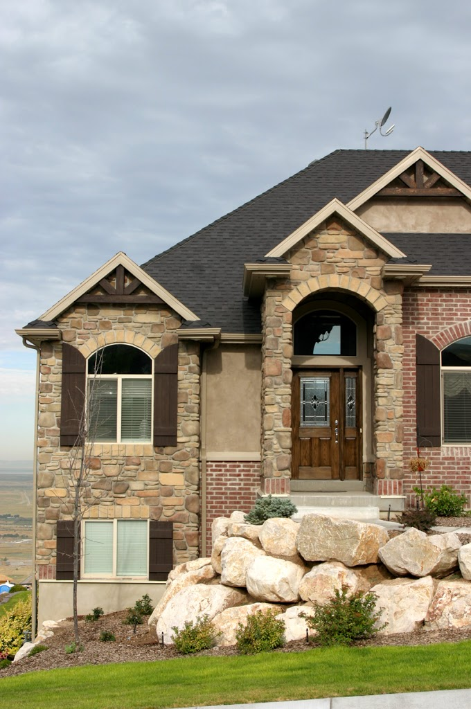 Shutters with brick stone hearth and home distributors for Mixing brick and stone exterior
