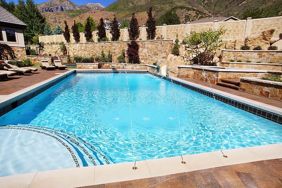 Retaining walls around the pool deck why you should be for Natural stone around pool