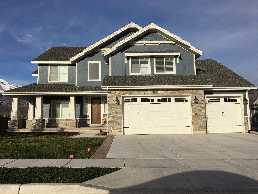 Three new platinum ledgestone homes hearth and home for Modern homes llc