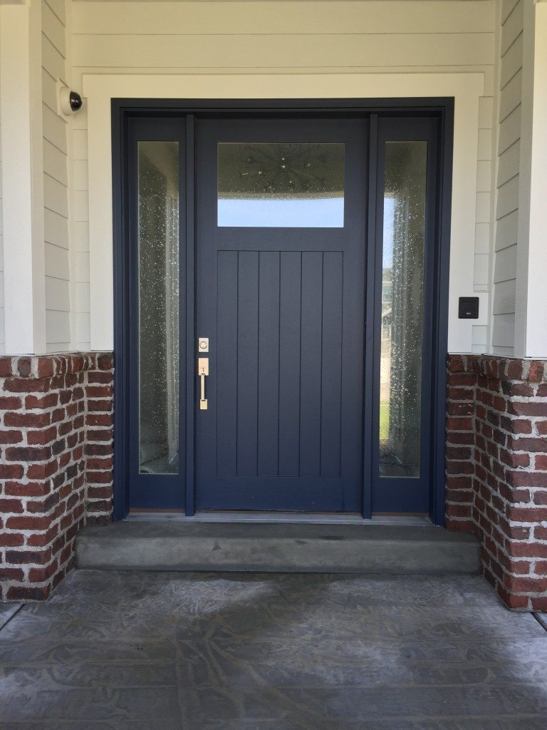 Dark blue front doors -  Brick On Your Exterior Try Out This Red River Pioneer Tumbled Brick This Was Actually Featured On A Parade Home Last Year With A Navy Colored Door