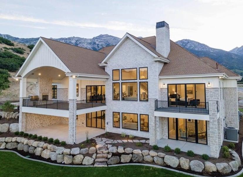 Highland Custom Homes Utah Valley Parade of Homes 2020 Back Elevation showing natural stone & white brick